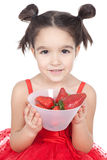 Little girl with strawberry on white background Stock Photo