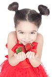 Little girl with strawberry on white background Royalty Free Stock Photos