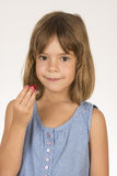 Little girl with a strawberry Royalty Free Stock Image