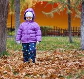The little girl on the street, in a down jacket Stock Photo