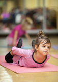 Little girl stretching Stock Images