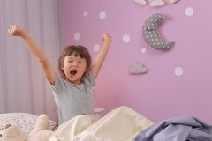 Free Little Girl Stretching In Bed At Home. Time To Sleep Royalty Free Stock Photos - 122735998