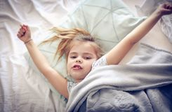 Stretching in bed. stock images