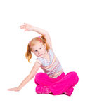 Little girl stretching studio Stock Photography