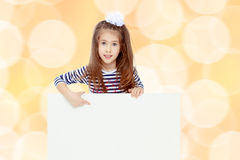 Little girl in a striped dress. Royalty Free Stock Photography