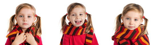 Little girl in a striped scarf photos Stock Photos