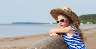 Little girl in a striped vest and hat Royalty Free Stock Images
