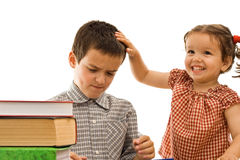 Little girl stroking the boy's head Royalty Free Stock Image