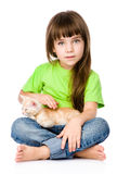 Little girl stroking a kitten. isolated on white background Stock Image