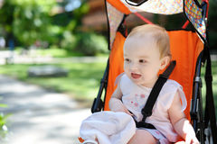 Little girl in a stroller Royalty Free Stock Image
