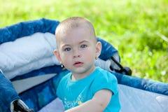Little girl in a stroller Stock Image