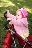 Little girl in the stroller Stock Photography