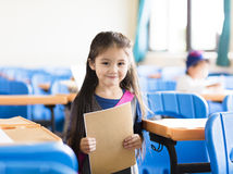 little girl student in the classroom stock photo