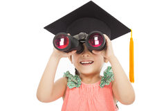 Little girl student looking through binoculars. Royalty Free Stock Photo