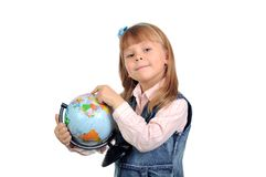 The little girl studies the globe Royalty Free Stock Photo