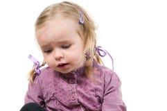 A little girl in studio. A little cute girl sitting in studio Stock Photos