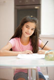 Little girl studying Stock Image