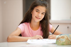 Little girl studying Royalty Free Stock Image