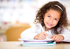 Little girl studying Royalty Free Stock Photo