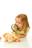 Little girl studying a basketful of chicks Royalty Free Stock Photography