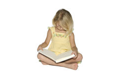Little Girl Studying Book Royalty Free Stock Images