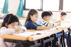 little girl studying  in the classroom Stock Photography