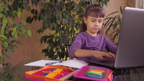 Little girl studying on a laptop stock video footage
