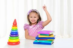 Little girl is studying literature Stock Photo