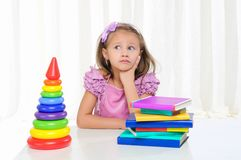 Little girl is studying literature Stock Photos