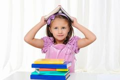 Little girl is studying literature Royalty Free Stock Images