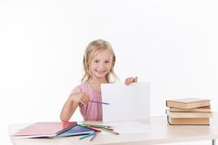 Little girl studying literature and smiling. Royalty Free Stock Images