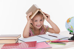 Little girl studying literature and smiling. Royalty Free Stock Photo