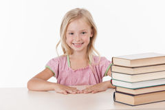 Little girl studying literature and smiling. Stock Image