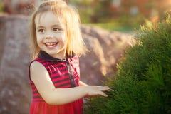 Little girl studying nature. joyful child in a good mood. stock photo
