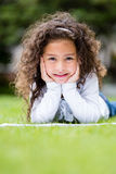 Little girl studying outdoors Royalty Free Stock Image