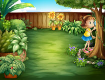 A little girl studying the plants in the garden Stock Photography