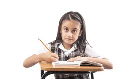 Little girl studying on white background royalty free stock images