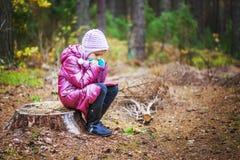 Little girl on stump Royalty Free Stock Photos