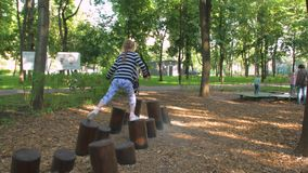A Little Girl On Stumps stock video footage