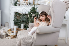 Little girl in a stylish festive Christmas interior. Stock Photography