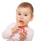 Little girl sucking toy Royalty Free Stock Photos