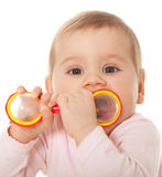 Little girl sucking toy Royalty Free Stock Images