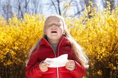 Little girl suffering from seasonal allergy stock images