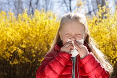 Little girl suffering from seasonal allergy outdoors stock photo