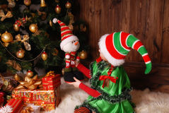Little girl in suit of the Christmas Elf with gifts Stock Photos