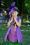 The little girl in a suit of violet flower is smiling Royalty Free Stock Photo