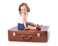 A little girl on the suitcase Stock Photo