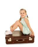Little girl with suitcase Royalty Free Stock Photos