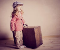 Little girl with suitcase Royalty Free Stock Image