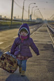 Little girl with a suitcase near the railway. outdoor Stock Photos
